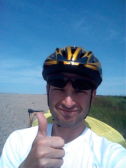 A mocking thumbs up. Actually it was hot and I was crashed out on the side of the road looking for some inspiration. None came but I got up and rode anyway.